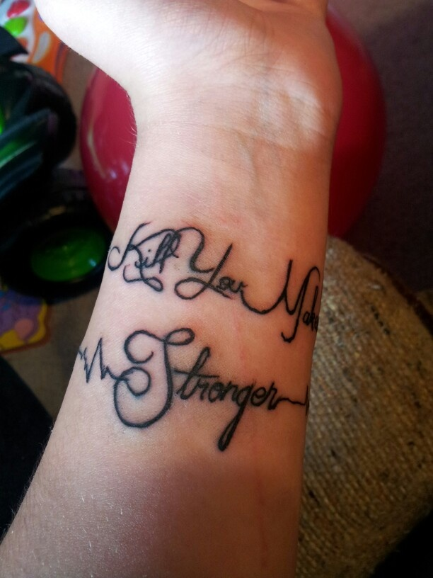 My first tattoo. Goes around my wrist. What Doesn't Kill You Makes You Stronger with heart monitor line