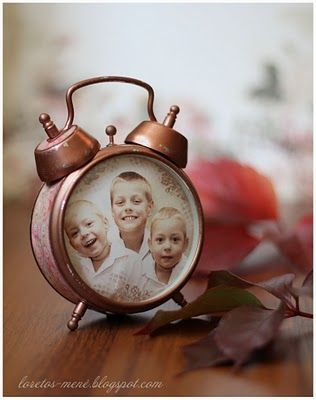 A vintage #upcycled alarm clock repurposed as a picture frame. Looks great with sepia colouring.