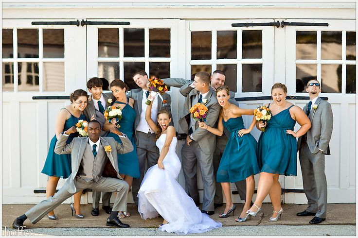 As silly as this picture is (I love it!), I am totally entertaining this color scheme for my wedding. The teal is my FAVORITE color, and it would look great with the orange flowers I have in mind (...looks like this bride had the same idea!). Also...Pring doesn't want to wear black. I really like the color of the mens' suits!