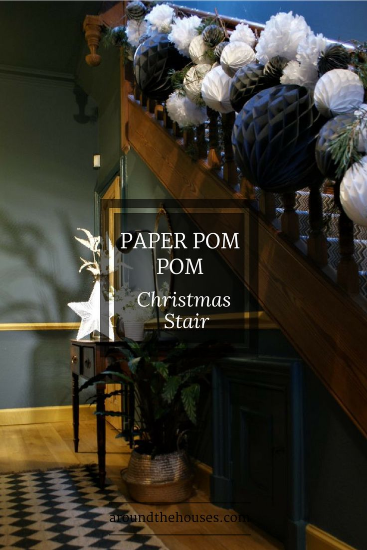 Paper Pom Pom Christmas Stair. Simple styling tips to give your staircase big impact for minimal expense.
