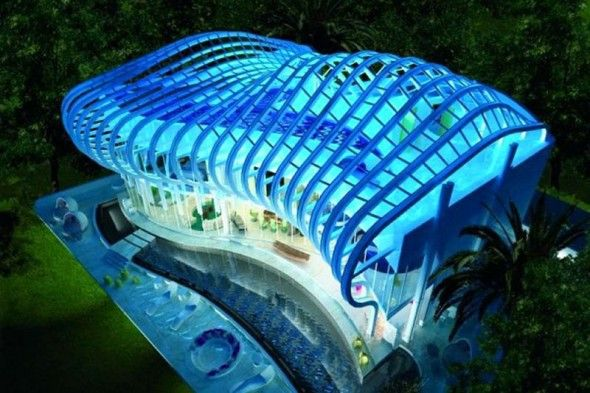 The blue lighting, and the way the ring shaped roof connected by metal rods creates an underwater look and modern building