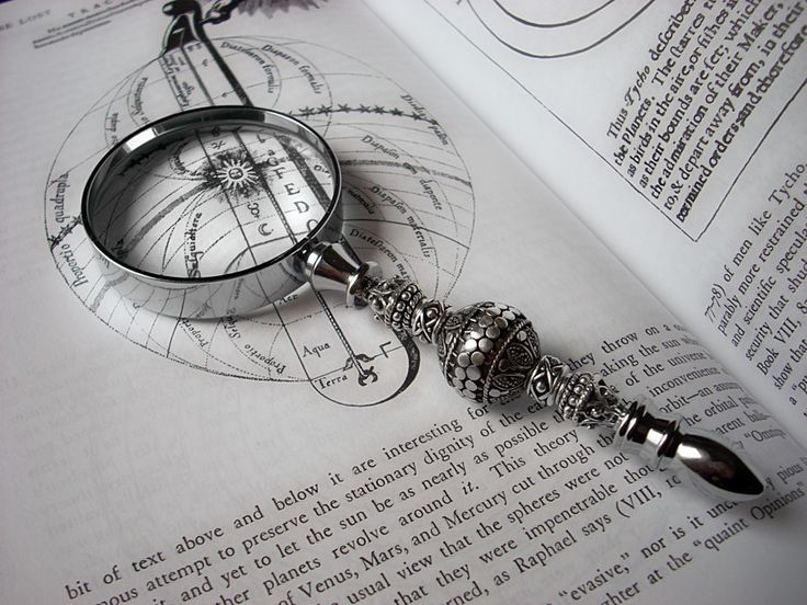 Got to have a magnifying glass or two with which to pour over the volumes of books -- Ornate Magnifying Glass by *Aranwen on deviantART