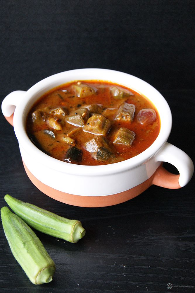 Vendakkai Puli Kuzhambu - A spicy and tangy South Indian Okra gravy. Add it to rice along with a drop of ghee and kootu as a side, and it would taste amazing. One of the best lunch recipes any South Indian would love to have.