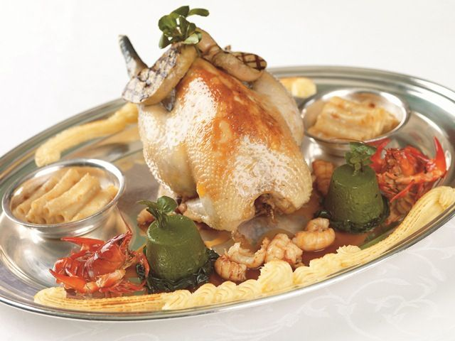 """Pot-roasted chicken of Bresse served with crayfish tails, small cassolette of macaroni and a """"vin jaune"""" sauce"""
