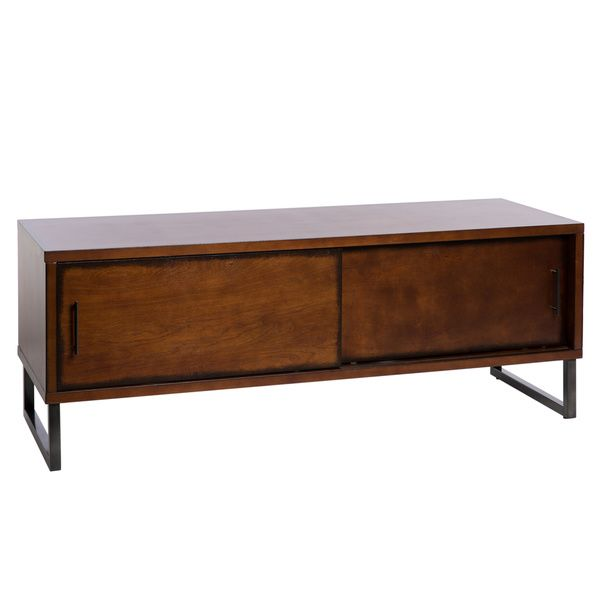 Showcase your TV and electronic devices with this 54-inch contemporary entertainment center from Breckenridge. This retro-styled brown entertainment center has two sliding doors and four power cord cu