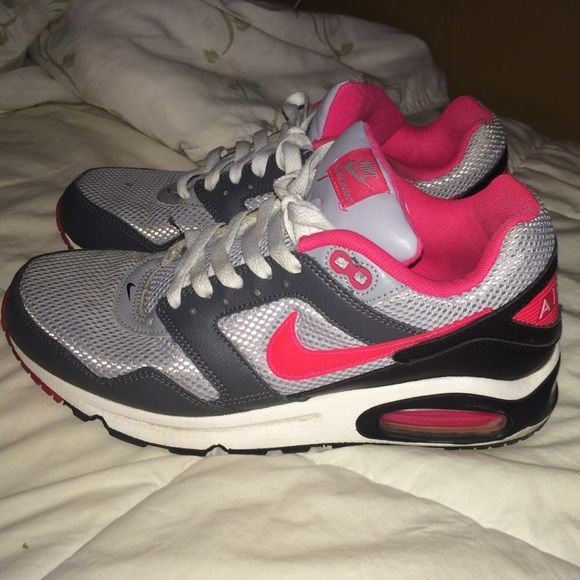 Black, gray, and pink Nike Air Max sneakers Black, gray and pink Nike Air Maxes. Size 9 worn but in good condition! Shoe laces are a little dirty and small spot on the top of right shoe Nike Shoes Sneakers