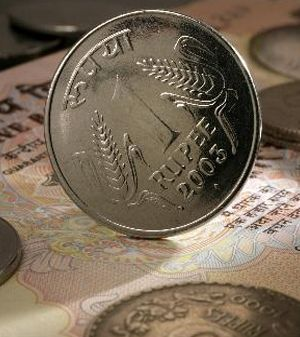 The rupee fell to a record low on Friday as Reserve Bank of India measures to tighten capital outflows and curb gold imports were seen as unlikely to prop up the currency and could even spark further selling if they spook foreign investors.