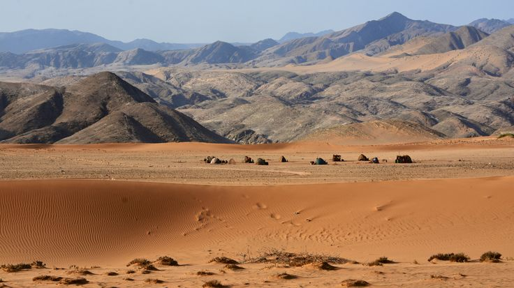 Himba village in the gorgeous landscape of the Hartmann's Valley