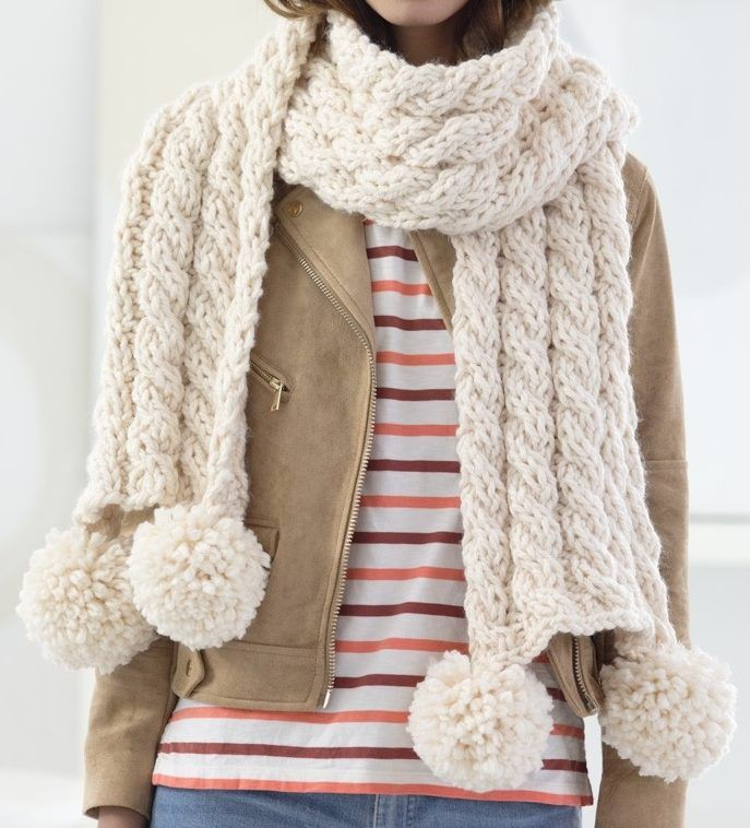 Free Knitting Pattern for 4 Row Repeat Cabled Scarf - This easy scarf features a 4 row repeat cable pattern and pompoms. Quick knit in super bulky yar