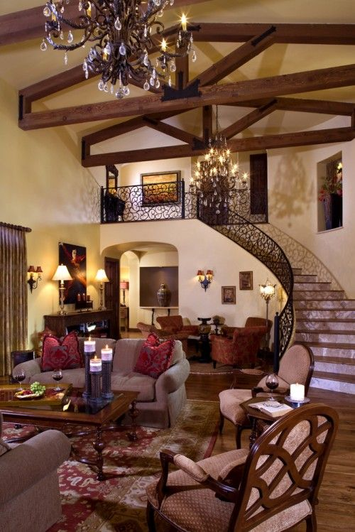 not my style of interior decorating, but love the shadows, lighting, beams, railing etc... Fabulous space!