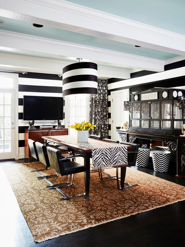 Vern Yip went big and bold with his newly remodeled kitchen and dining room space. Large stripes in Alabaster SW 7008 and Black Magic SW 6991 adorn the walls while the Open Air 6491 SW ceilings give the space a light, bright levity.
