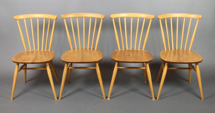Lot 986, A set of 4 Ercol light elm stick and rail back dining chairs with H framed stretchers, raised on turned supports, the base marked B.S.J.F. 1960 2056, sold for £100