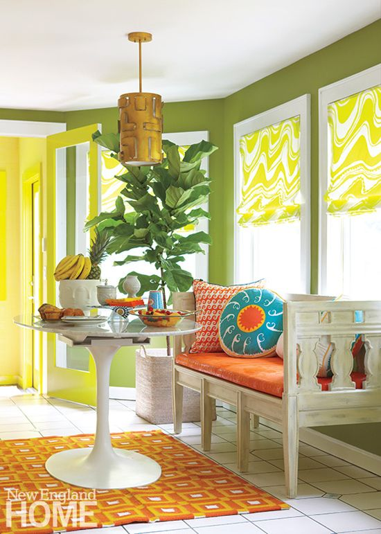 Green walls paired with yellows & oranges, surprisingly tropical and fun!