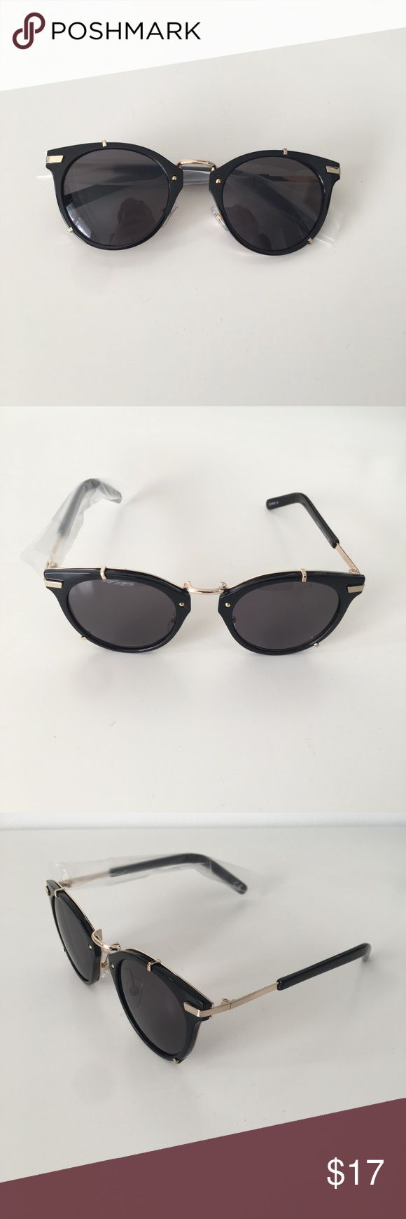 Black & Gold Sunglasses These Foster Grant sunglasses combine a retro-inspired style with an exquisite shiny black frame and pops of gold accents. The faux gold clips give the illusion of a vintage clip-on that's oh so trendy right now! Featuring 100% UVA/UVB protection, these sunglasses are the perfect blend of form and function. Brand new, never worn! Brandy Melville Accessories Sunglasses