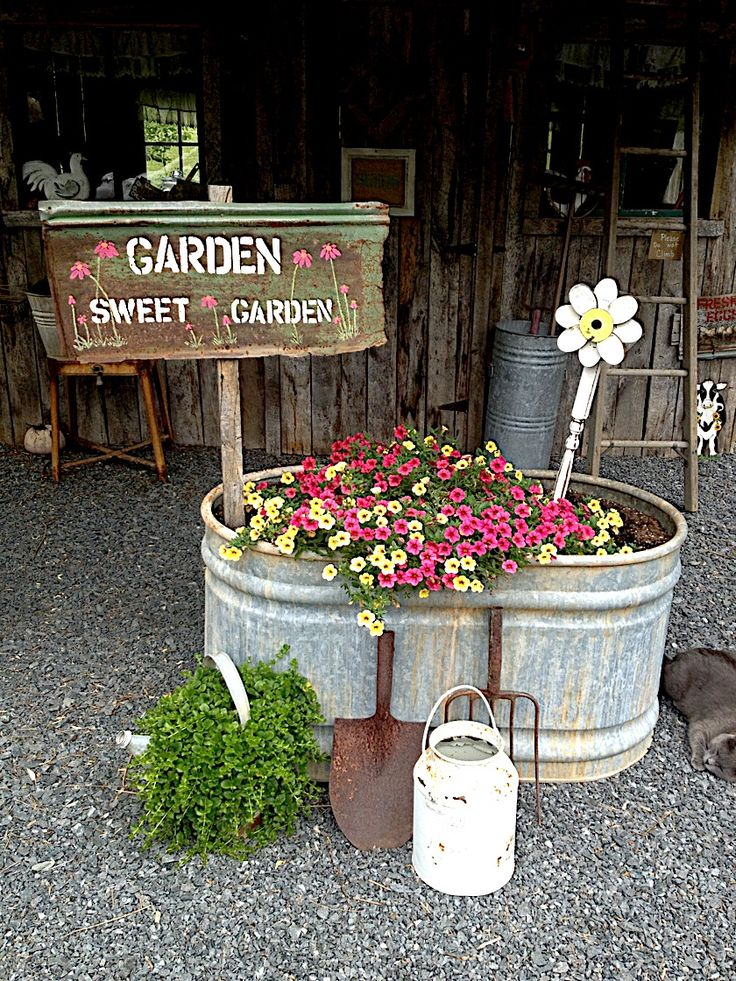Garden shed-I love the flowers in the trough.  I have a trough like that that has a broken weld, it leaks water but I'll bet in won't leak flowers...