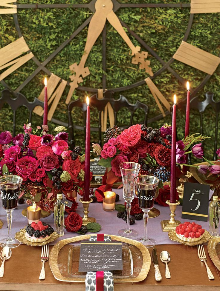 Gold and jewel tones mix with Paris accents. Low centerpieces encourage conversation, while calligraphed glasses double as place cards. A boxwood wall, an oversize Parisian clock and mini-bottles of St–Germain transport guests to a European backyard.