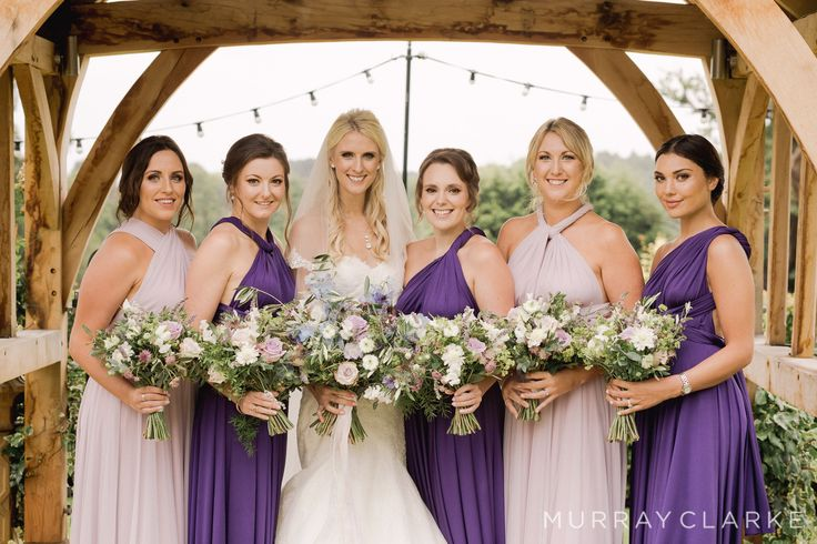 Wild style bridal bouquets at Russets House of lilacs and blues created by Eden Blooms Florist from Nigella, Silverado Rose, Ocean Song, Pale Blue Delphinium,Olive, Alchimilla, Oregano, Flowering Mint, Asparagus Fern.  Images by https://www.murrayclarke.co.uk/