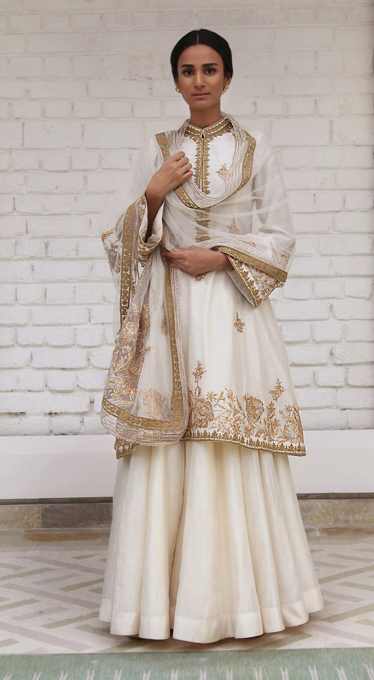 Rimple & Harpreet Narula. Ivory Chanderi silk A-line shirt featuring delicate gotta and tilla dori embroidery; paired with a soft tulle dupatta and silk sharara