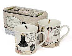 Muggar i presentbox med mönster av modedockor i retro-stil.