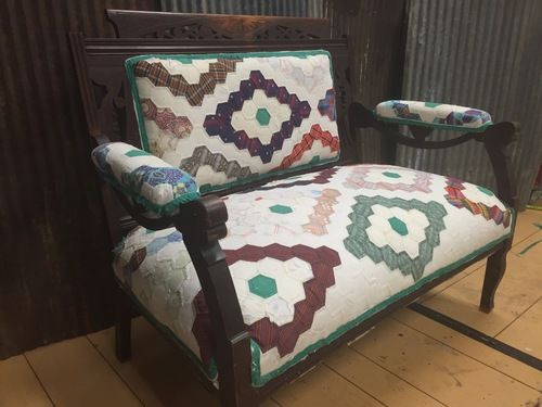 Laura Locke of Turning Leaf Crafts repurposed a vintage quilt into a unique covering for an antique settee. The quilt donated by musician Sheryl Crow will be auction off at the June City Farmhouse Pop-up Fair. The proceeds from the auction will benefit Sheryl's charity - the Syrian Refugees.