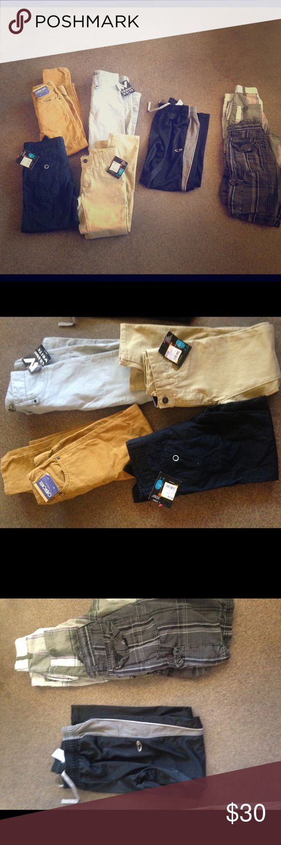 Boys size 8 back to school lot Shawn white NWT Awesome back to school lot with 3 pairs of brand new with tags boys Shawn white pants 1 pair of Cherokee NWT pants 1 pair C9 athletic pants and 3 pairs of plaid shorts(old Navy, vans) great deal considering tags on the pants range from $17-20 piece Shawn white Bottoms Jeans