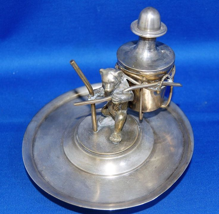 A characterful, unusual Victorian white metal inkwell with bear and staff figure