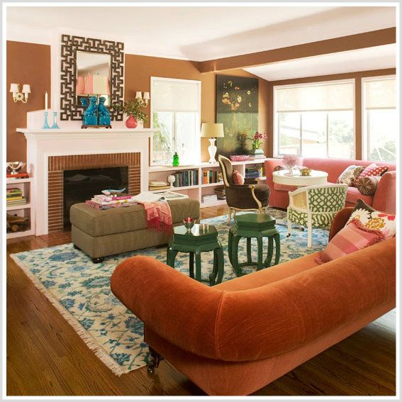 This living room is split complementary of orange blue and - Blue and orange color scheme for living room ...