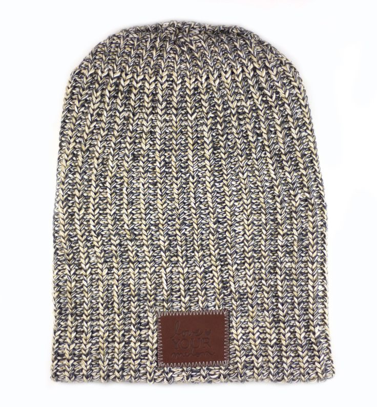 This beanie is knit out of 100% cotton yarn in a natural, charcoal, and hemp colors and features a brown leather patch that is debossed with the Love Your Melon logo. Made in the USA, machine washable
