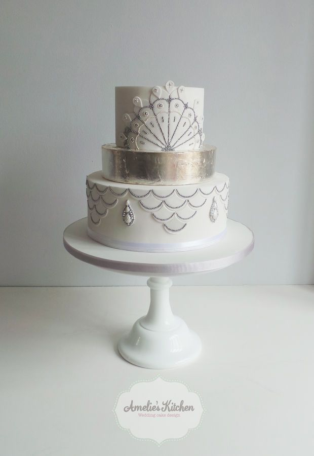 "I like the size of this cake, how the ""silver"" piece is a smaller piece that adds height and color. I would want it to be gold though."