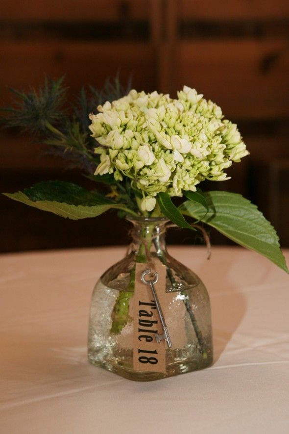 patron bottles put to beautiful use @Tara Goldsborough that is a  LOT of patron so you better get started now.  I will need tons of decorations ;)