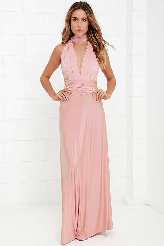 """Any which way you wrap it, the Always Stunning Convertible Blush Pink Maxi Dress is one amazing dress! Two, 83"""" long lengths of fabric sprout from an elastic waistband and wrap into dozens of possible bodice styles including halter, one-shoulder, cross-front, strapless, and more. Stretchy blush fabric has a satiny sheen, and a full length maxi skirt pairs perfectly with any choice you make up top. Want Styling Tips? <a href='http://bit.ly/HowToWearIt' target='_blank'>See How To Wear It!</a>"""