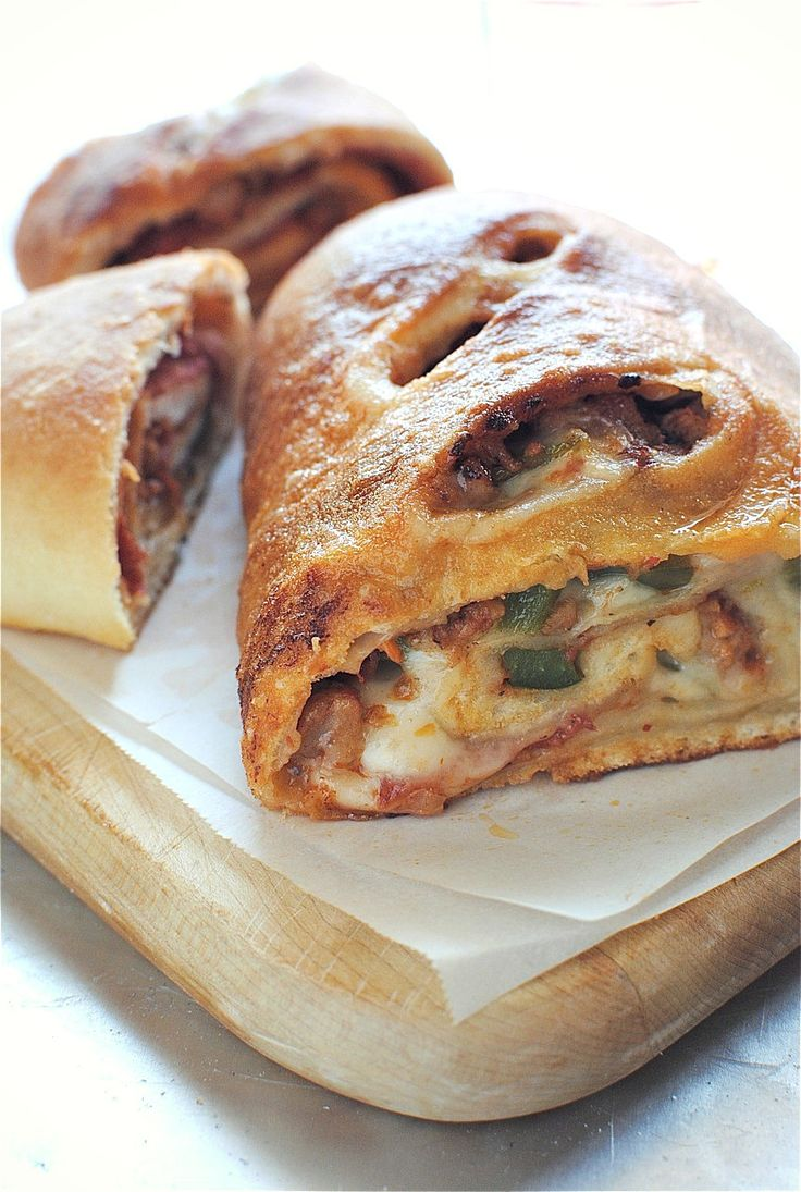 Italian Sausage and Pepperoni Stromboli. Very similiar to Calzones but shaped differently. They slice up nice for appetizers better imo but find a filling that will stay together luke warm and you are good to go! Years of variations, people loved them all.