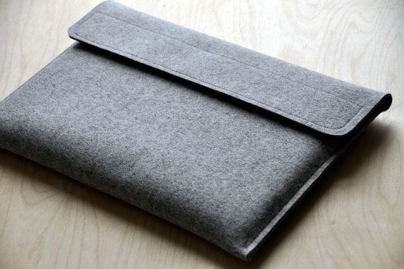 I made one of these cases for myself almost a year and a half ago and have decided to start making them for other people to enjoy! I hand cut and sew all of these myself.    This case fits the current unibody 13 inch macbook pro and uses thick, 3mm 100% wool felt to keep your laptop safe from dings and dents. It has a simple, elegant, design with a natural grey felt, and black heavy duty velcro. The contrast of the two colors when open is stunning! The velcro is a nice, soft cushion so there…
