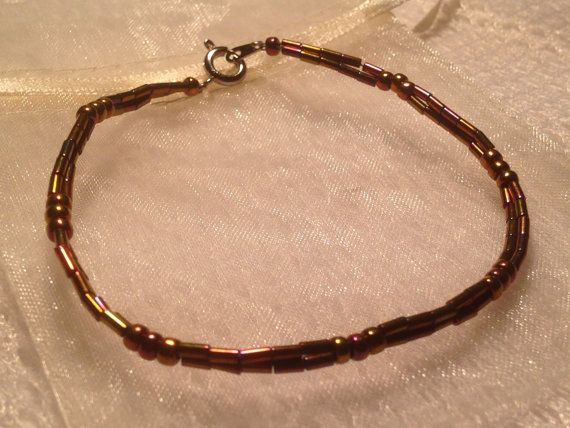 Beaded bracelet - copper with a red tinge - handmade from quality Japanese seed beads and bugles. Includes cream organza gift bag. on Etsy, $9.95 AUD
