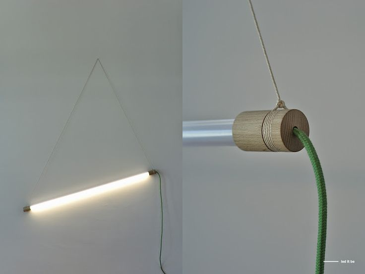 """A modern fluorescent LED lamp framed in wood and string is a recipe for """"LED IT BE"""" – a lamp ideal for use in a variety of interior spaces.The fluorescent LED tube is powered as a standard light bulb and does not require frames or additional adapters. These are the main assumptions of the concept of the lamp, which change the existing patterns of thinking about the form of linear lighting and its technical purpose."""