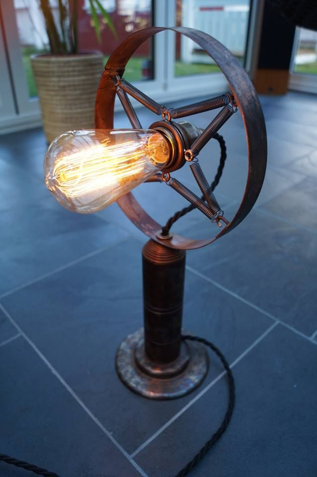 Table lamp inspired by old analogue microphones.