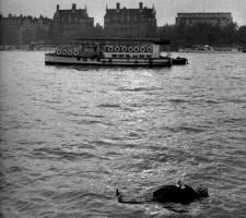 Alfred Hitchcock floating on the Thames.