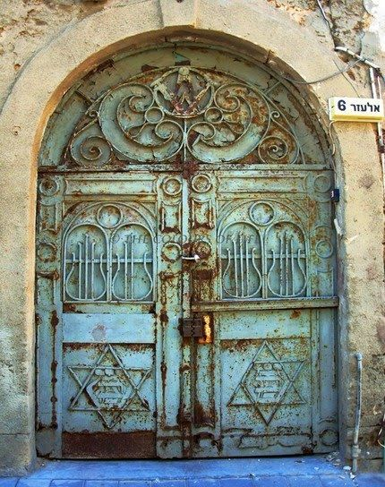A door in a jewish community in Israel, I can see the star of David on each side on the bottom. Beautiful symbol!