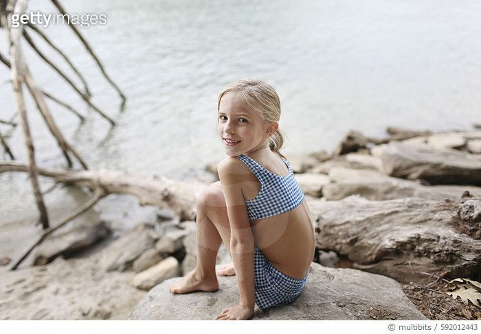 Caucasian girl in bikini sitting by remote lake - gettyimageskorea