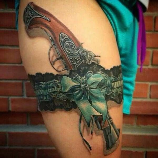 I'm not a huge fan of gun tattoos but this one is gorgeous. Very detailed and well done.