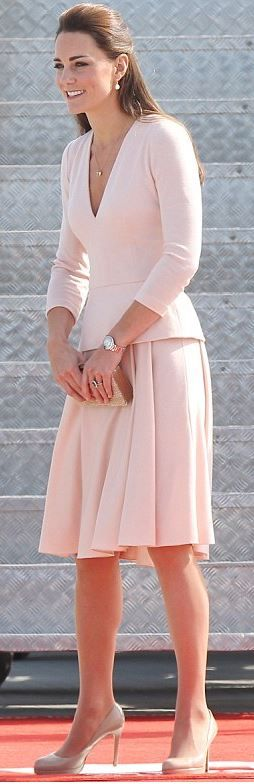 Kate Middleton: Shirt and skirt – Alexander McQueen  Shoes – L.K. Bennett  Watch – Cartier  Earrings – Annoushka