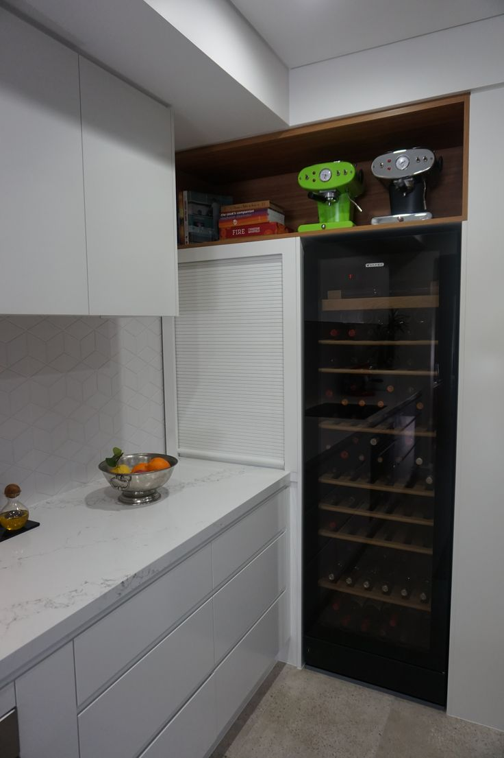 Two tone kitchen Tall wine fridge open space to display old style coffee machines
