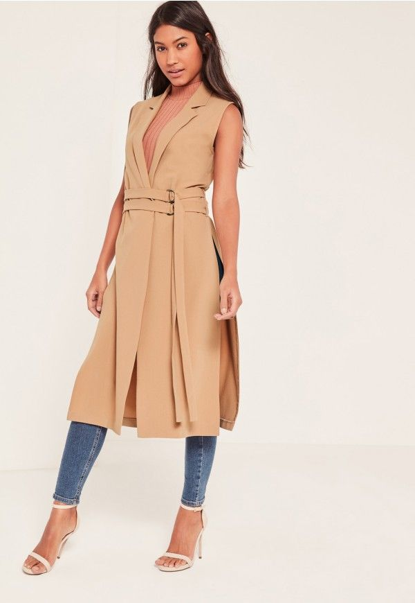 Sleek and chic, this modern duster coat will add a polished look to any outfit.