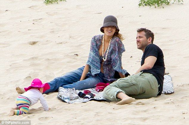 Family day: Blake and Ryan set up a blanket on the beach...