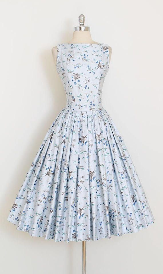 ➳ vintage 1950s dress * gorgeous printed dress * tiny blue birds and floral print * full skirt * polished cotton * metal back zipper condition | excellent fits like xs/s length 46 bodice 18 bust 36 waist 26 ➳ shop http://www.etsy.com/shop/millstreetvintage?ref=si_shop ➳ shop policies http://www.etsy.com/shop/millstreetvintage/policy twitter | MillStVintage facebook | millstreetvintage instagram | millstreetvintage 5936/1715