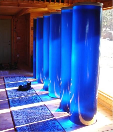 Fiberglass water storage tube tanks for passive solar heating & cooling system Trombe walls. Prevent temperature swings in greenhouse or sunroom by storing excess solar energy.