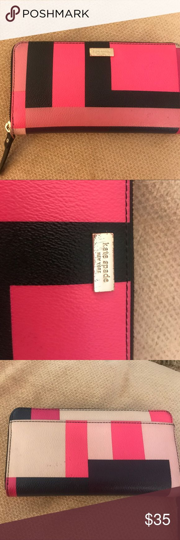 Kate Spade Ladies Wallet This fun and adorable Kate Spade wallet is pre / owned in good condition! Zips up to keep Credit Cards and cash safe! Fun wallet !! kate spade Bags Wallets