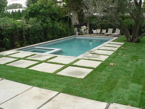 love the pavers and shape of this contemporary pool