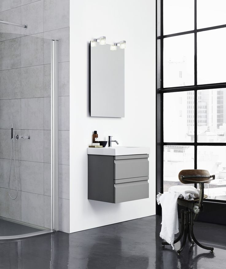 Timeless Menuet washbasin here combined with stylish grey rubber vanity unit.