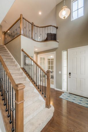 Traditional Staircase with Hardwood floors, High ceiling, Carpet, Pendant Light